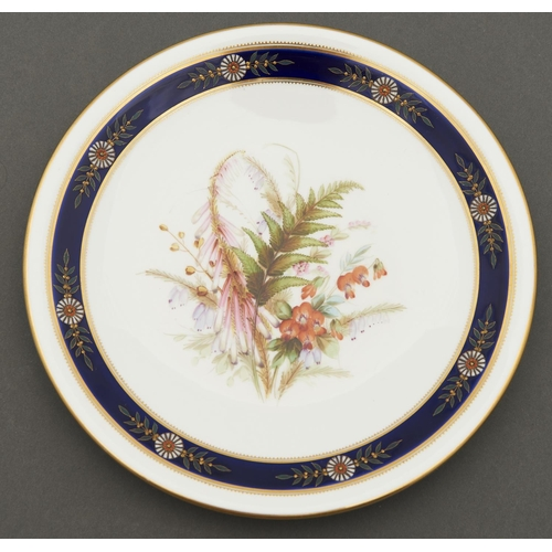 798 - A Royal Worcester plate, 1879, painted with heaths in cobalt and raised gilt border, rim gilt, 22.5c...