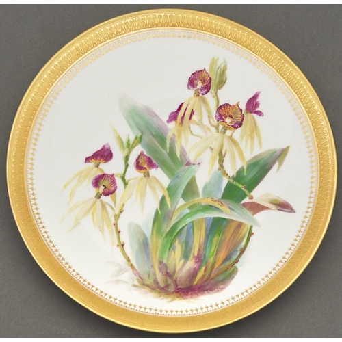 799 - A Minton bone china plate, 1879, painted by W Mussill, signed, with orchids, in etched gilt border, ...