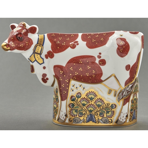 809 - A Royal Crown Derby Daisy Cow paperweight, 15cm h, printed mark, silvered stopper