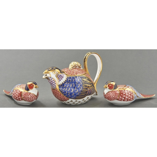 811 - A Royal Crown Derby Imari pattern Partridge teapot and cover and two paperweights, teapot 13.5cm h, ...