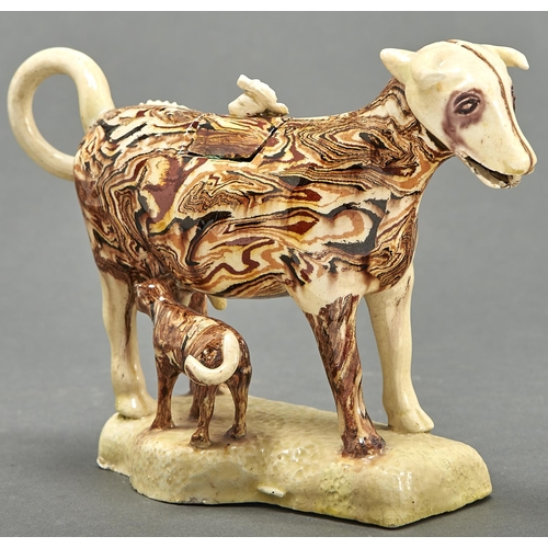 850 - A Staffordshire creamware cow creamer and cover, early 19th c, with marbled or agate glaze, the cove...