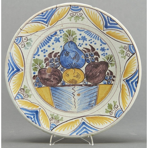 858 - A Dutch polychrome Delftware dish, c1770, painted in cobalt, green, manganese and yellow with fruit ...