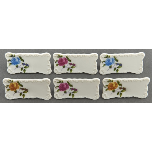 877 - A set of six Continental porcelain place stands, early 20th c, printed and painted with a blue, yell...