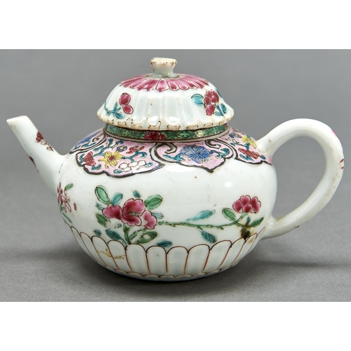 882 - A Chinese chrysanthemum moulded famille rose teapot and cover, Qing dynasty, Qianlong period, enamel...