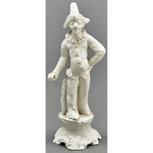 895 - A Continental glazed porcelain commedia dell'arte figure of Pulcinella, 19th c,16.5cm h...