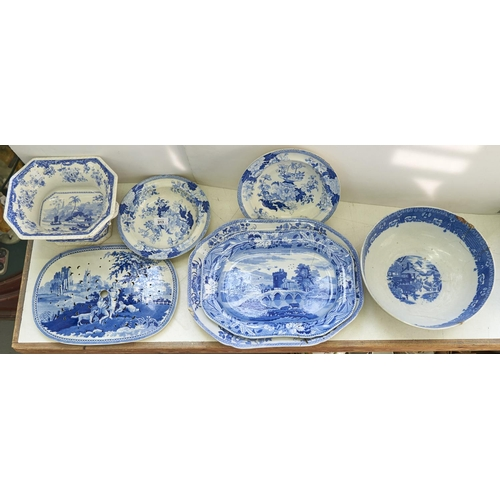 913 - An English pottery pearlware bowl, printed in blue and white with chinoiserie scenes, 30cm diam, riv...