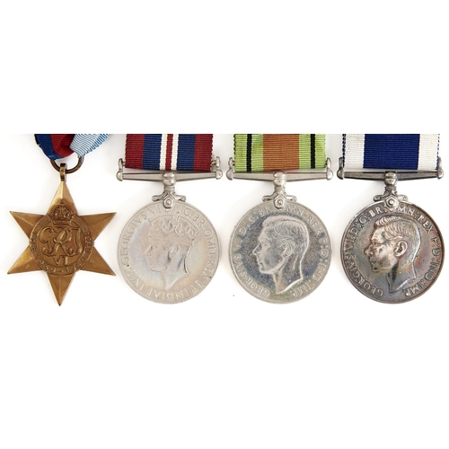 966 - WWI group of four, 1939-1945 Star, British War Medal, Defence Medal and Royal Naval Long Service and...