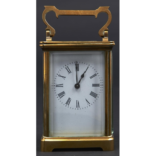 978 - A French brass carriage timepiece, early 20th c, with enamel dial, 11cm h excluding handle...