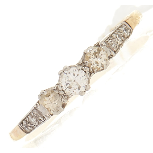 99 - A three stone diamond ring, in gold marked 18, 1.8g, size O½