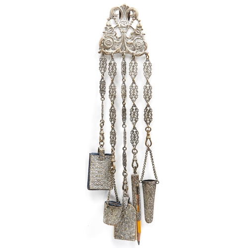 992 - A fin de siecle stamped and plated brass chatelaine, c1890, of five implements hanging from decorati...