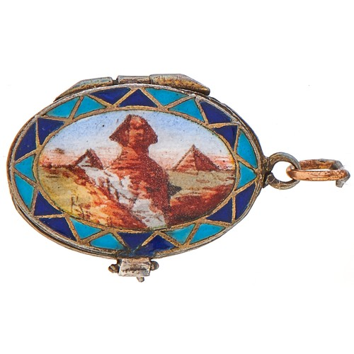 243 - An Egyptian style silver and enamel baby in a basket charm