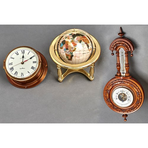 1132 - A carved walnut aneroid barometer with enamel dial, 45cm, a reproduction terrestrial globe, 25cm w a...