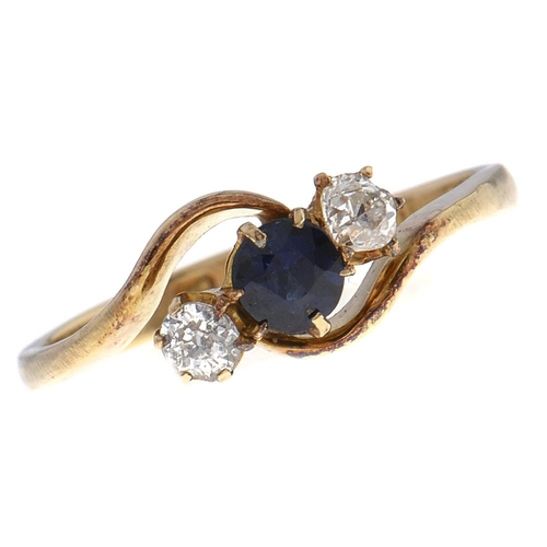 502 - A sapphire and diamond crossover ring, in 18ct gold, Chester 1912, 2.5g, size L½