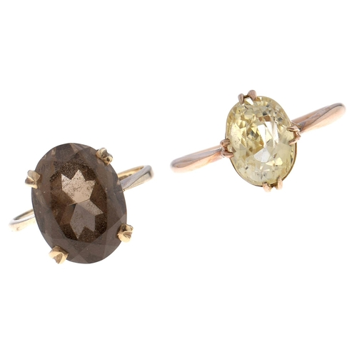 505 - Two citrine rings, in gold marked 9ct or 9ct gold London 1975, 7.5g, sizes Q and J