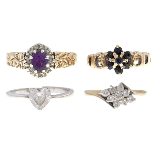 507 - Three gold rings, variously gem set, 6g and another ring, various sizes