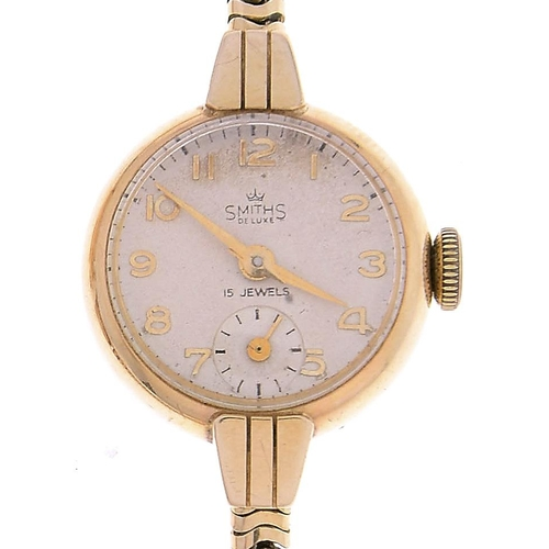 509 - A Smith's 9ct gold lady's gold wristwatch, Deluxe,21mm, Chester 1955, on 9ct gold Brazilian mesh b...