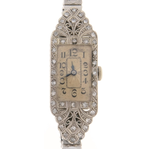 522 - An Art Deco diamond cocktail watch, with Ruler movement, millegrain set in 18ct white gold, 14 x 42m...