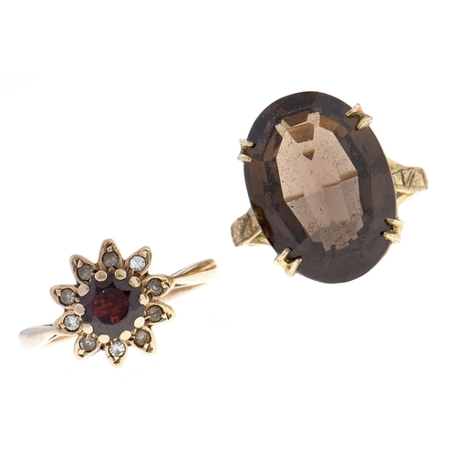 535 - A citrine ring and a garnet and white stone cluster ring, mid 20th c, both in 9ct gold, sizes K&frac...