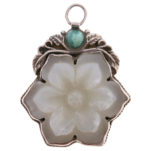 550 - A Chinese celadon jade flower pendant, early 20th c, the chased silver mount with turquoise cabocho...