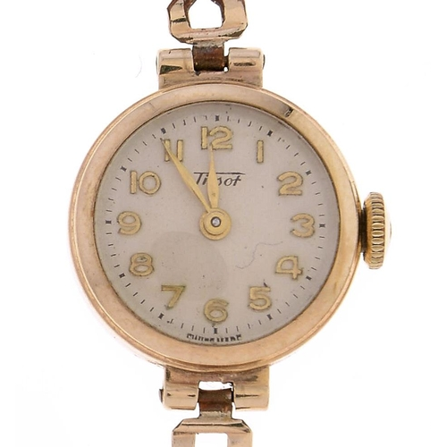 557 - A Tissot 9ct gold lady's wristwatch,17mm, Birmingham 1957, gold plated bracelet,...