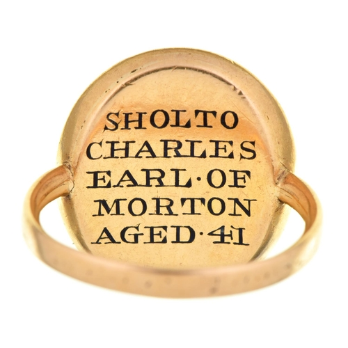 18 - A gold and enamel mourning ring, 1774,inset with hair, the reverse enamelled in black SHOLTO CHARLE...