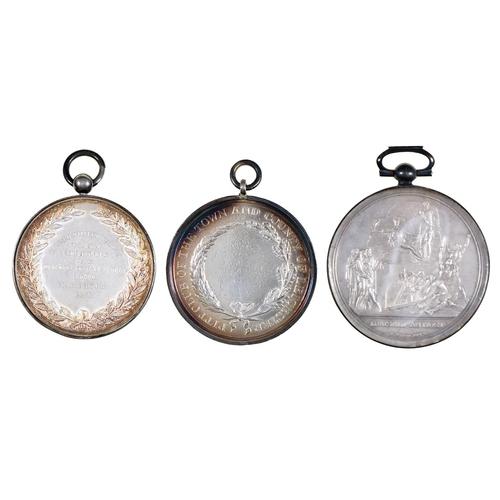 23 - ManchesterPitt Club and Merchant TaylorsSchool pit club silver medals, 19thc,by T Wyon Jr or Ben...