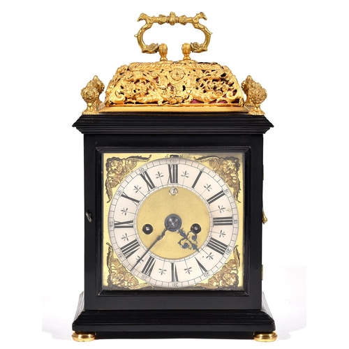 369 - An English basket top ebony clock, Nicholas Massy, dated 1686, the 17cm brass dial with matted centr...