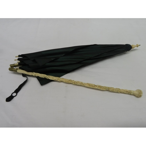 53 - Highly carved ivory handle with silk parasol...