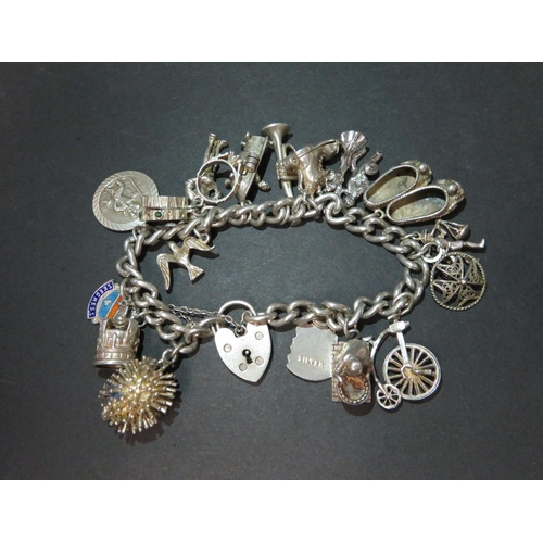 1a733c3ac4372 Vintage silver charm bracelet with 17 charms. Hallmarked from ...
