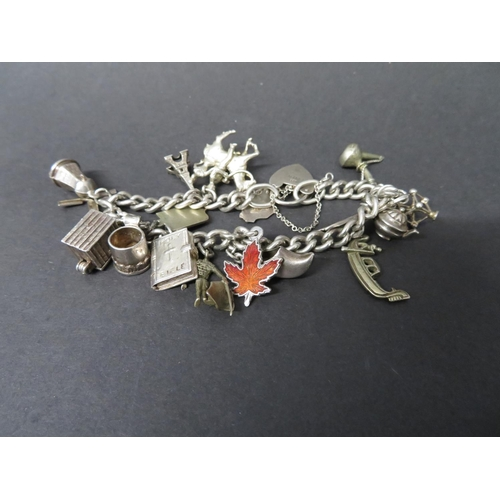31 - Vintage silver charm bracelet each link stamped with Lion Passant London 1961 54 grams...