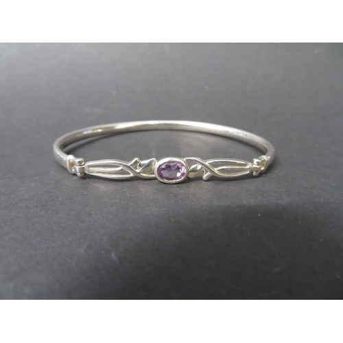 46 - Hallmarked silver Celtic design bracelet with with an amethyst stone 8.5grams...