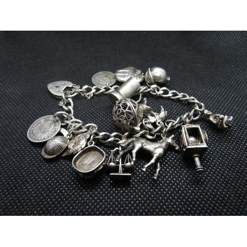 11 - Vintage silver bracelet George Jensen 15 charms padlock and safety chain 58g...