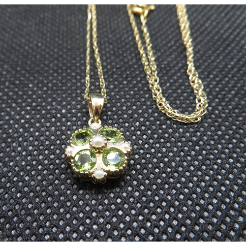 6 - 9ct gold peridot and pearl pendant on 9ct gold chain...