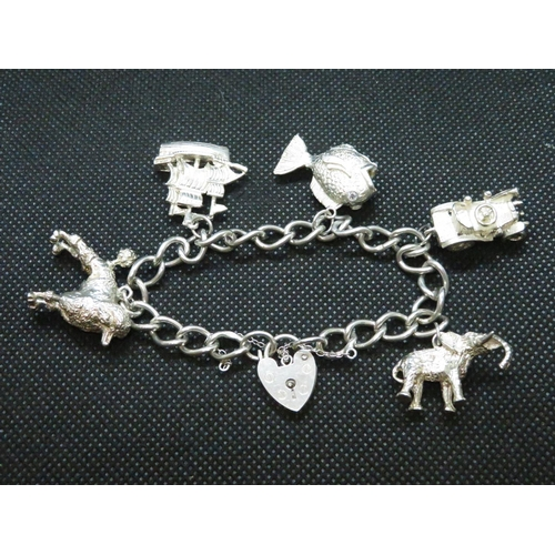 27 - vintage silver charm bracelet with 5 large silver charms London 1976 43g...