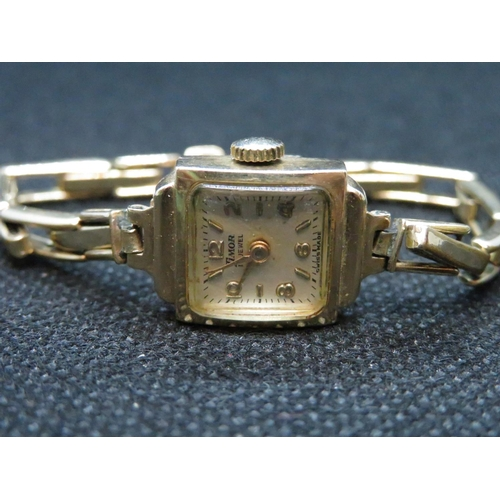 34 - Lady's 9ct gold watch with plated strap...