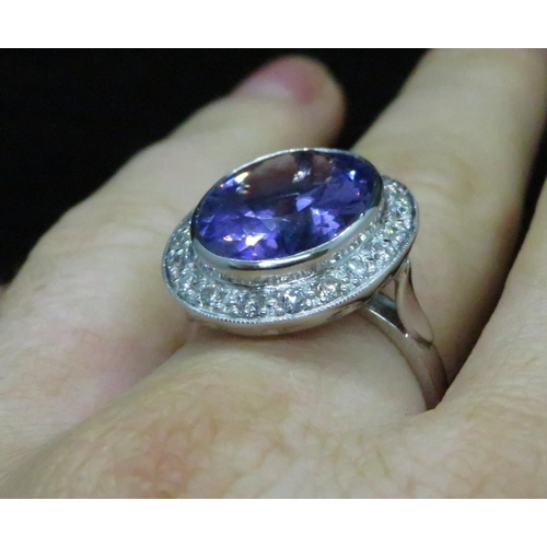 45 - Lady's 18ct white gold amethyst and diamond cluster ring half carat of diamonds...