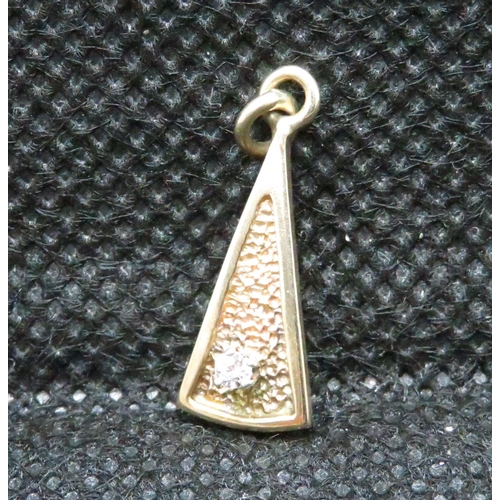 56 - 9ct gold and diamond pendant .8g...