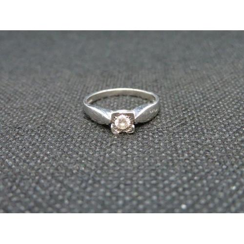 59 - 9ct white gold with .12 carat diamond 2.2g...