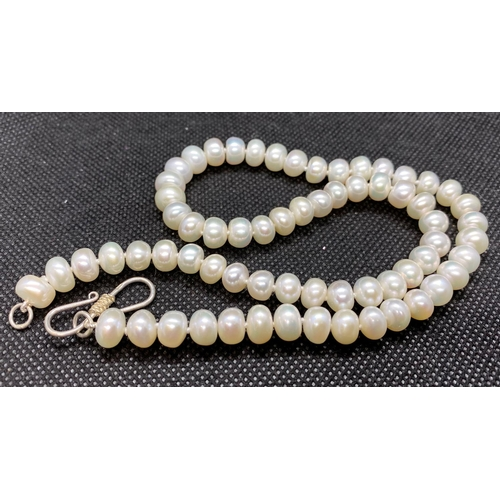 20 - String of freshwater pearls with silver catch 18