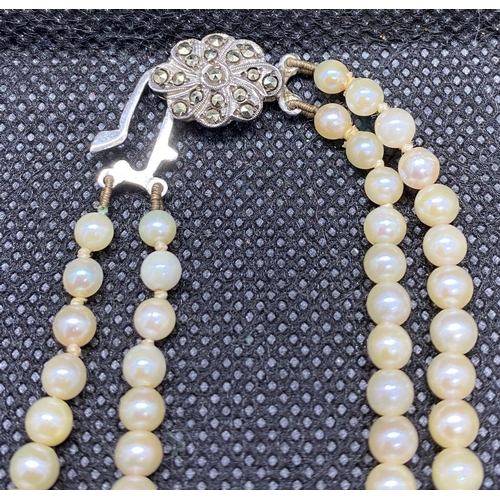 37 - Fine quality double row of graduated cultured pearls in fitted case...