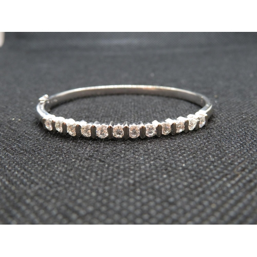 236 - 18ct white gold bangle 18g of gold with 12x .2ct diamonds - exceptional quality in almost new condit...