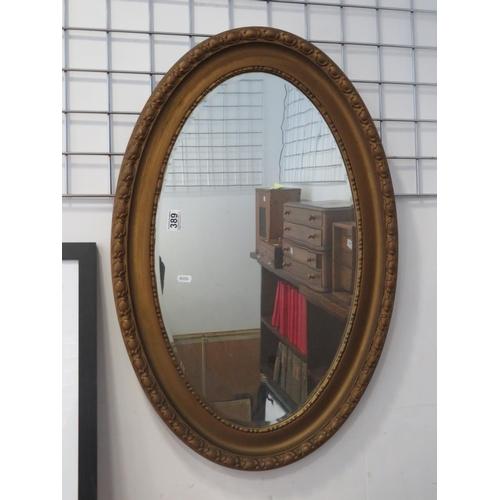 "Oval bevelled edge framed mirror 28 x 20"""