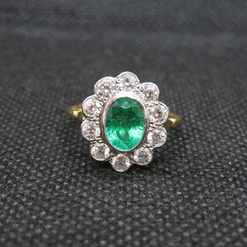 7 - 18ct gold and platinum cluster ring with central oval emerald approx 1.2ct with 10 natural brilliant...