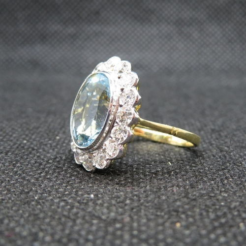 44 - Stunning 18ct gold cluster ring centre oval aquamarine approx 5cts with 16 brilliant cut diamonds we...