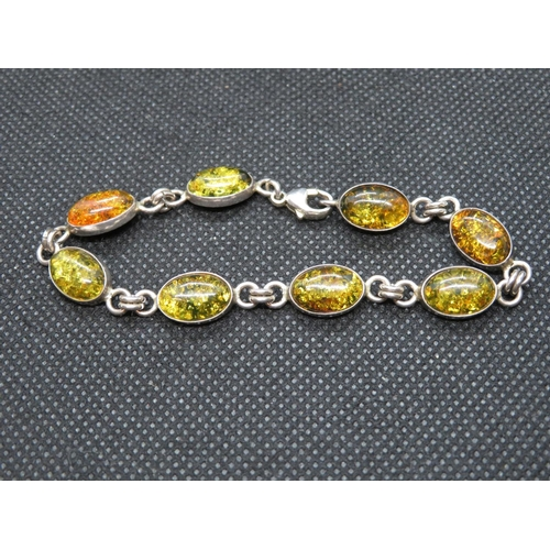 53 - Silver bracelet set with Baltic amber 7.25