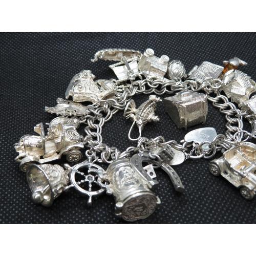 56 - George Jensen vintage silver bracelet with 21 unusual and rare charms GJ Ltd. HM London 1972 116.4g...
