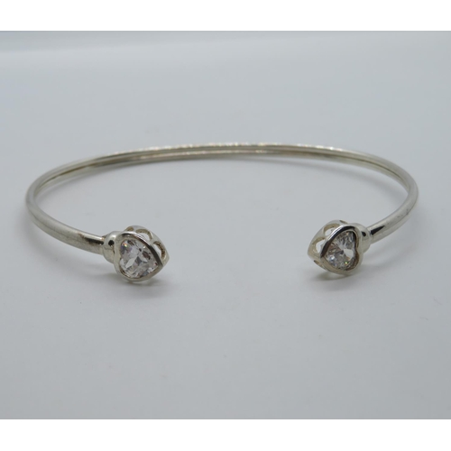 Silver bangle with heart terminals set with CZ stone