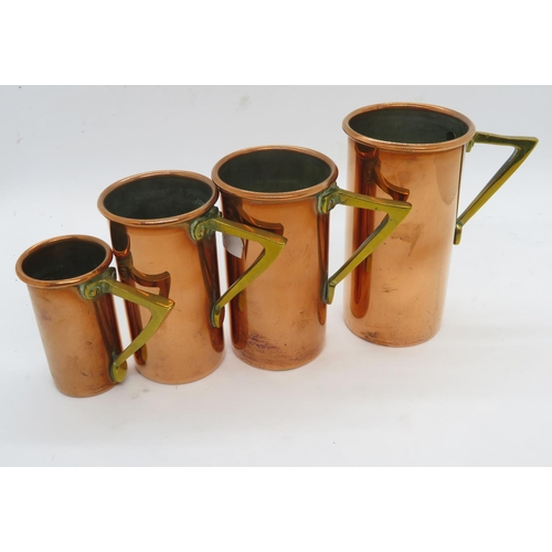Graduated set of copper measuring cups from .25 - full