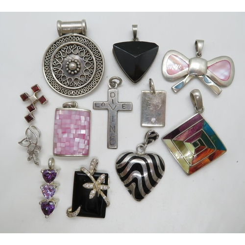64 g silver pendants