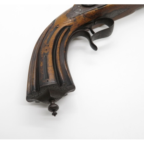 16 - Highly carved early duelling pistol by Acier